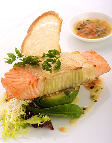 pan fried fillet of salmon on avocado iwht passion fruit and tomato relish